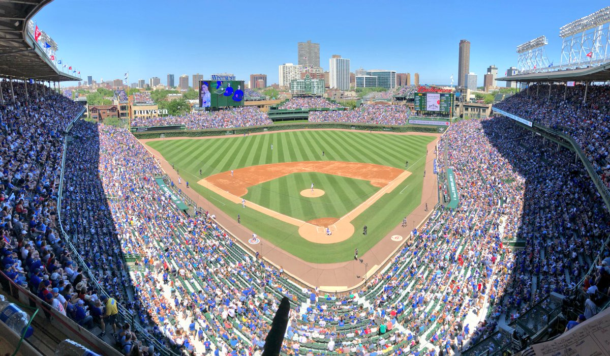 Pat Hughes calls the view from the booth today a beautiful postcard picture day at Wrigley Field