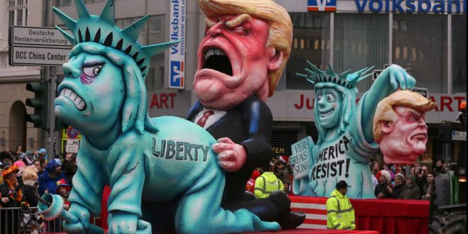 This is not recent, but who cares. The procession is part of Germany&#39;s annual &quot;Rosenmontag&quot;, which come just before Lent. It is a tradition for the carnival floats to mock the political themes of the day. #Liberty<br>http://pic.twitter.com/szaFRywXAw