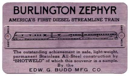 According to Wikipedia, this is a stainless steel card with two shotwelds souvenir by the Budd Company feat. the Burlington Pioneer Zephyr. Budd invented the process and used it to construct the Pioneer Zephyr. Later trains were made from the same steel as the card #trains