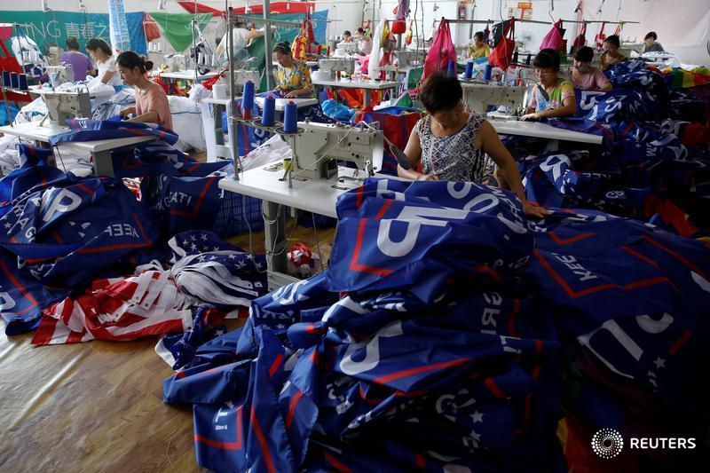 "Workers make flags for U.S. President Donald Trump's ""Keep America Great!"" 2020 re-election campaign at Jiahao flag factory in Fuyang, Anhui province, China"