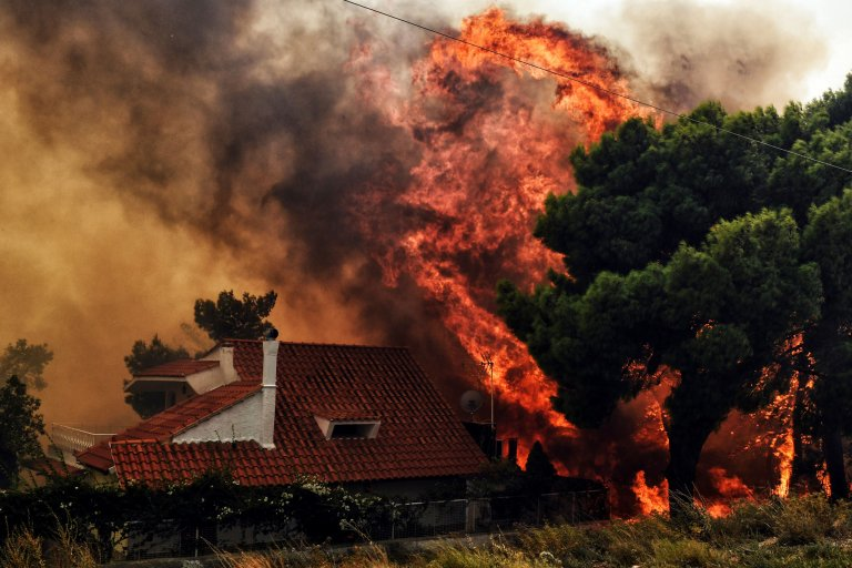 Climate change. It's here. It's catastrophic.  This month alone:  — '50 dead' in Greece wildfires — Arctic Circle ablaze — Japan heatwave, flooding and landslides kill hundreds — Record temperatures in Algeria, Morocco, Oman — Drought squeezes US lemons  📷 @AFP/@GettyImages