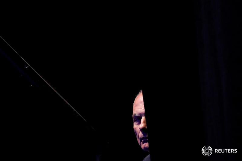 White House Chief of Staff John Kelly looks out from behind a curtain before President Trump addresses the Veterans of Foreign Wars' 119th VFW national convention in Kansas City, Missouri