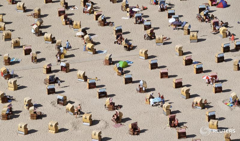 People enjoy the beach on the Baltic Sea in Travemuende, Germany