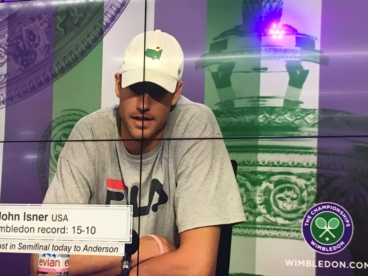 .@JohnIsner wearing a @TheMasters  hat during his press conference. What a great Georgian and Dawg. #UGA #Wimbledon