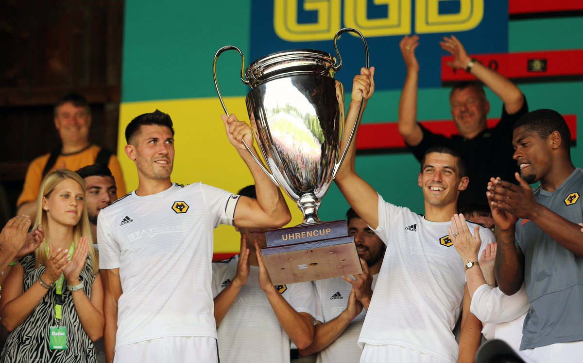 Conor Coady and @Danny_Batth lift the @Uhrencup trophy after Wolves wins over @FCBasel1893 and @BSC_YB. 🏆🇨🇭