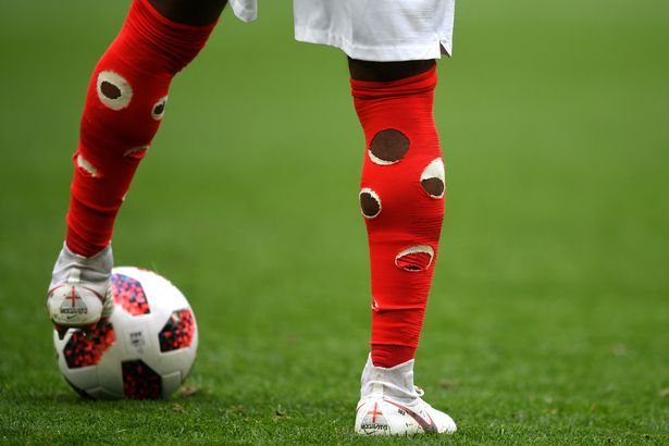 Why Danny Rose has holes in his socks as England face Belgium Photo