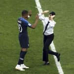 The most iconic image of the World Cup - France's Kylian Mbappé high fiving a member of Pussy Riot after she broke onto the pitch to protest political oppression in Russia