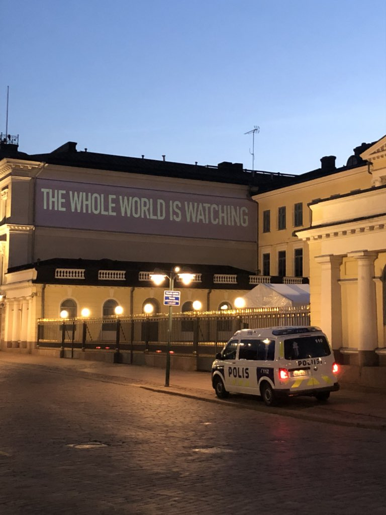 "Message ""the whole world is watching"" among others being projected onto presidential palace in Finland where Trump and Putin are meeting for their summit on Monday"