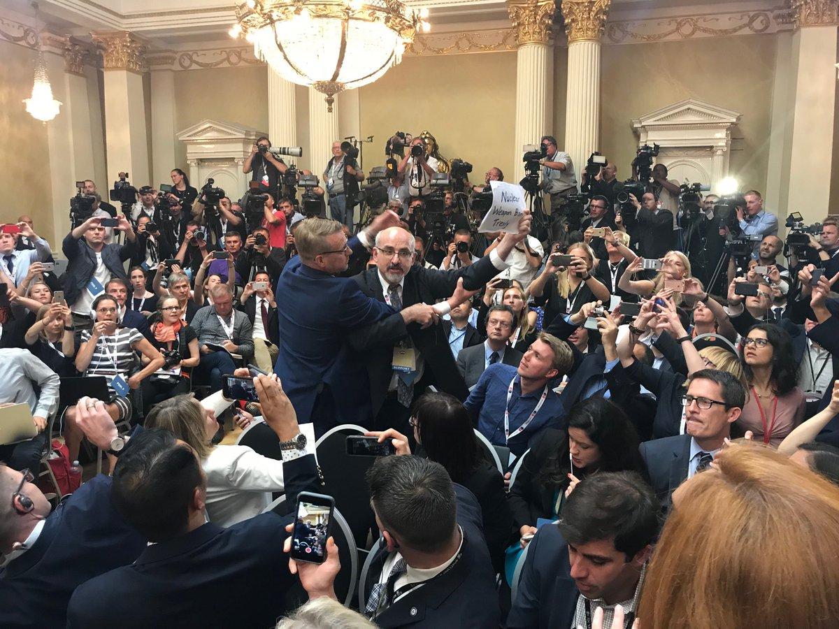 The protestor at Trump Putin presser.