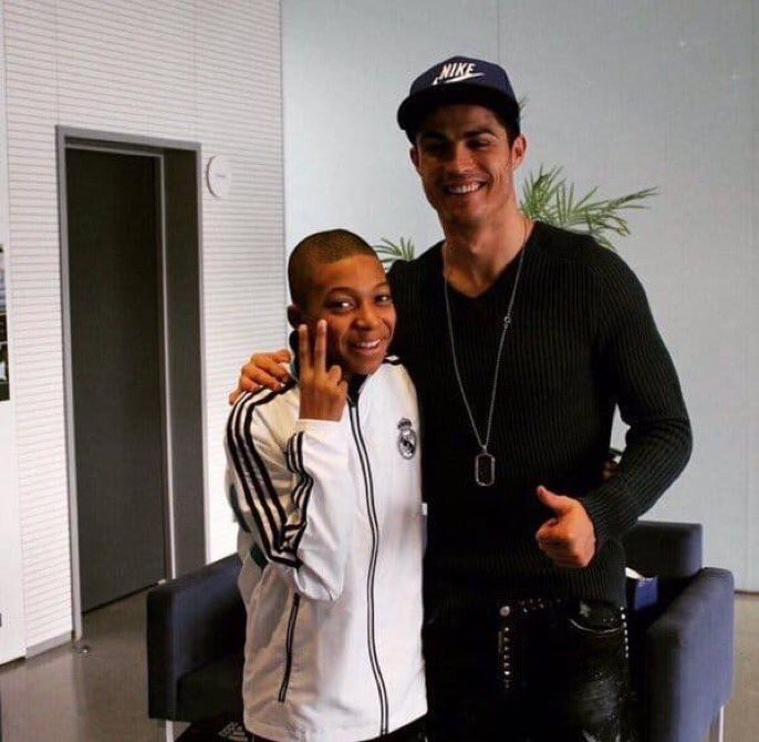Here is a picture of a World Cup winner with a fan.