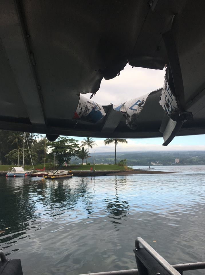 Photo shows damage after tour boat is hit by a 'lava bomb' off Hawaii's Big Island; up to 13 people are believed to be injured