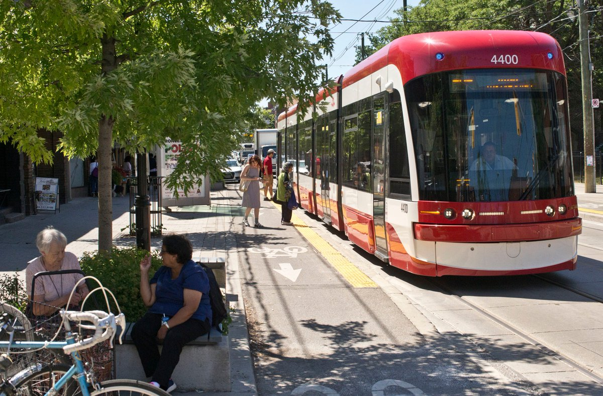 test Twitter Media - A reconfiguration of Roncesvalles Ave. removed one traffic lane in each direction, widened sidewalks, and created Toronto's first streetcar platforms that also double as cycling lanes. #bikeTO #walkTO (Photo: Lucas Oleniuk) https://t.co/5lBChizYJC https://t.co/3eO7Qfom7F