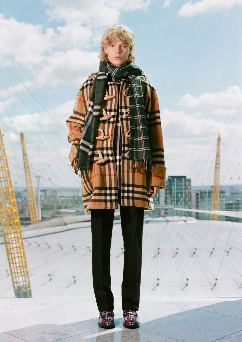 Aaron layers an oversized duffle coat, check flannel shirt and scarf from the second #GoshaRubchinskiyXBurberry drop, a limited-edition capsule celebrating our outerwear icons and the Burberry check brby.co/73u