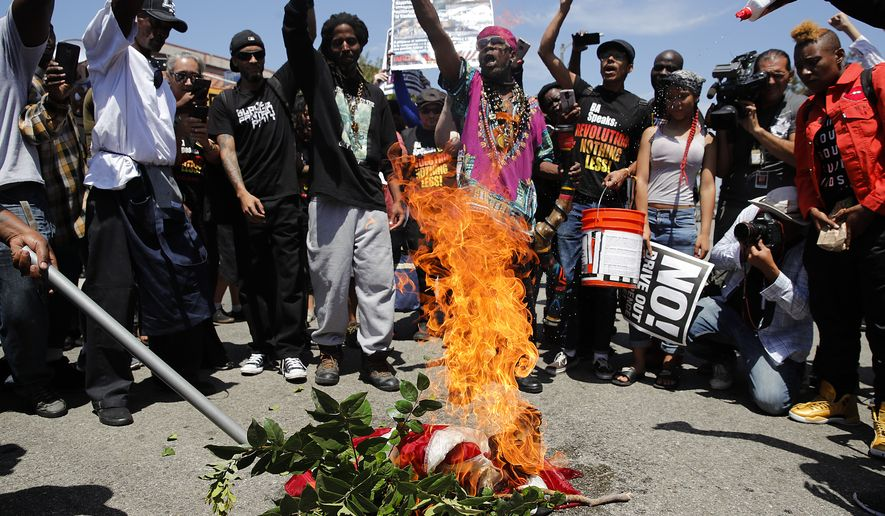Maxine Waters supporters chant 'black power,' burn American flag outside her office https://t.co/ZuVDELw8DG