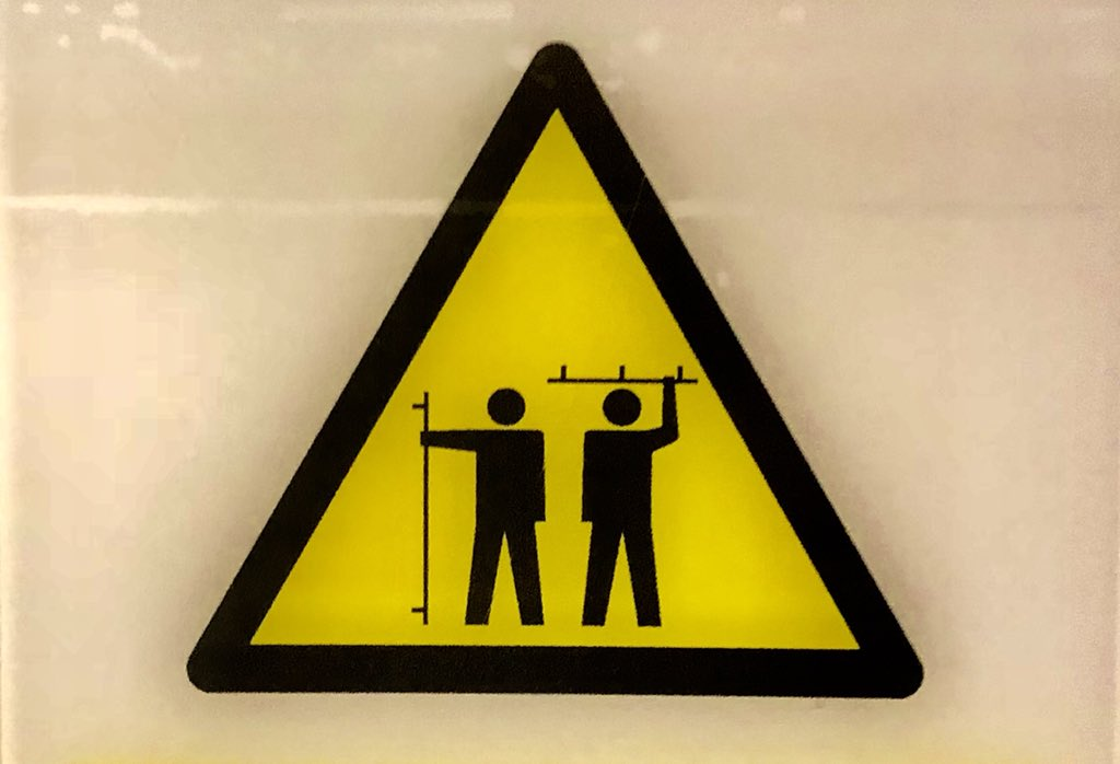A warning sign at Heathrow.  DEFEND YOURSELF
