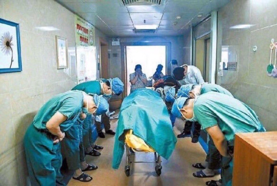 Chinese doctors bowing to 11 year old boy with brain cancer who saved lives by donating his organs.