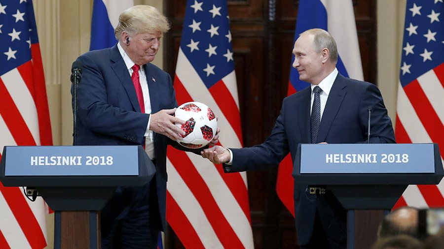 Political football: Vladimir Putin presents Donald Trump with a soccer ball from the World Cup at their meeting in Helsinki, Finland. See more of our photos of the week at: https://t.co/Bz3oxWeYn8