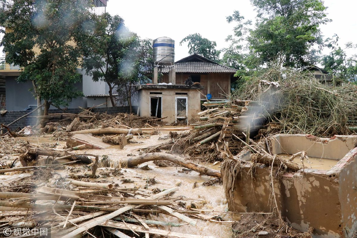 At least ten people have died after floods spurred by typhoon rains struck central and northern Vietnam, with another 11 missing, AFP reports