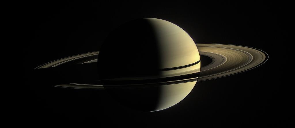 Behold, Saturn. Seen here in Jan. 2010, the rings on the day side are illuminated both by direct sunlight & by light reflected off the planet's cloud tops, while rings on the night side have been brightened to more clearly reveal their features: https://t.co/0H47swfBPP