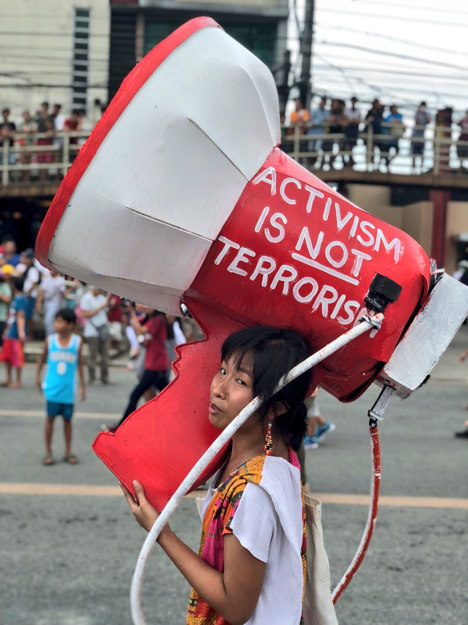 A protester carries this 'megaphone' while marching in Commonwealth Avenue #SONA2018 https://t.co/tTLWF3r3d0