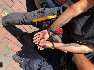 Photo of a man hands in handcuffs.