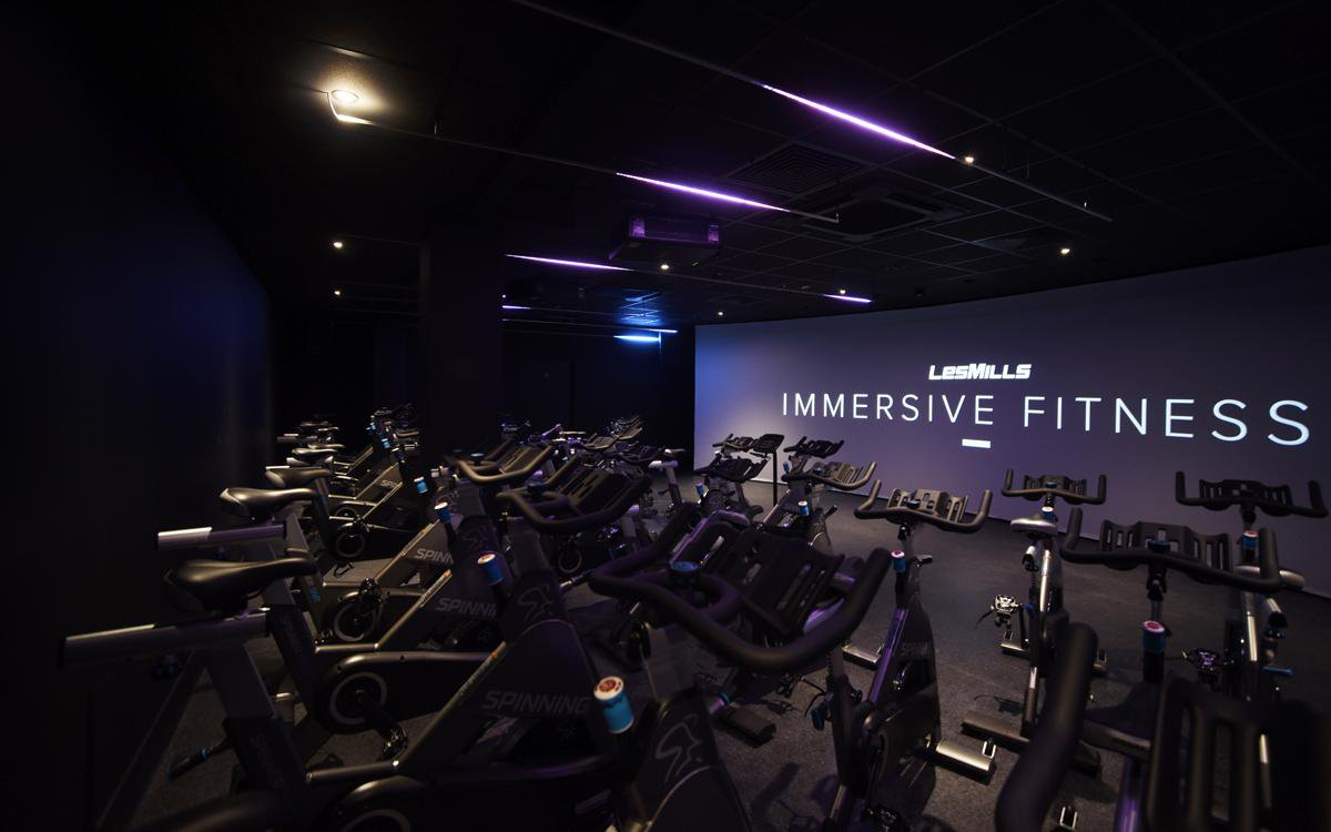 Image for Want to know how IMMERSIVE FITNESS™ works? In the first of a two-part series we take a look at THE TRIP - the revolutionary immersive cycling class by @lesmillsUK & explain how Hutchison-t delivers the technology to bring this complex experience to li