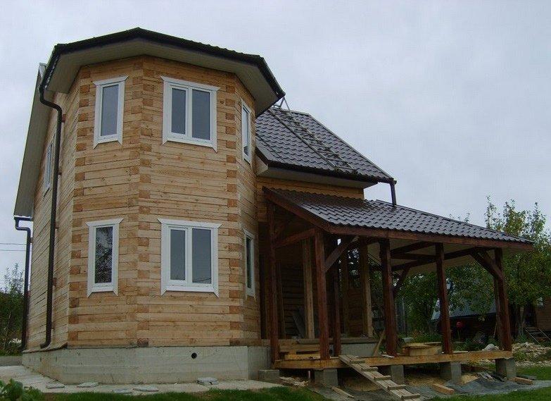Дома из бруса с эркером проекты фото