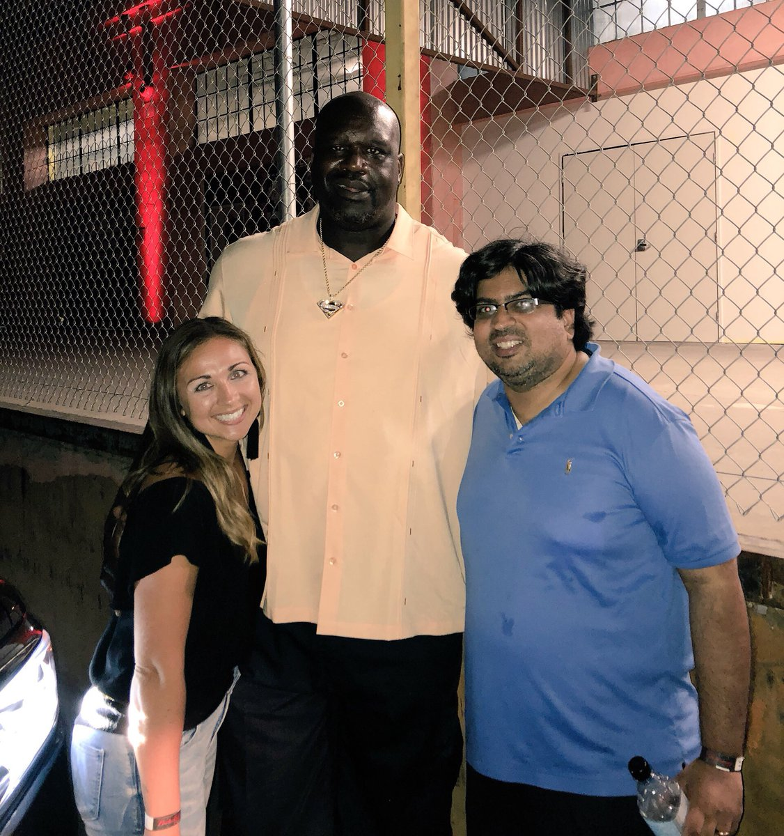 """""""just don't get shot tonight, okay?"""" — shaq, whispered in my ear right after this photo was taken 😂"""