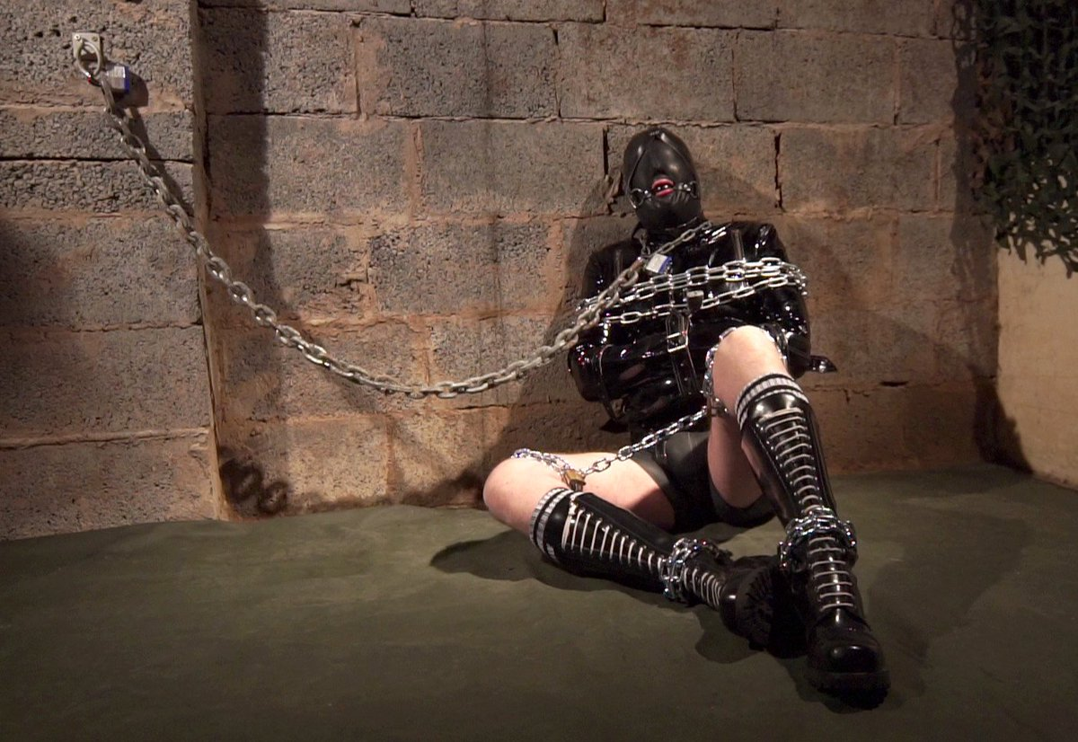 Patsypvc Transvestite Bondage Tied Up Dressed In Pvc Dress And Ballgagged And Chained To Wall