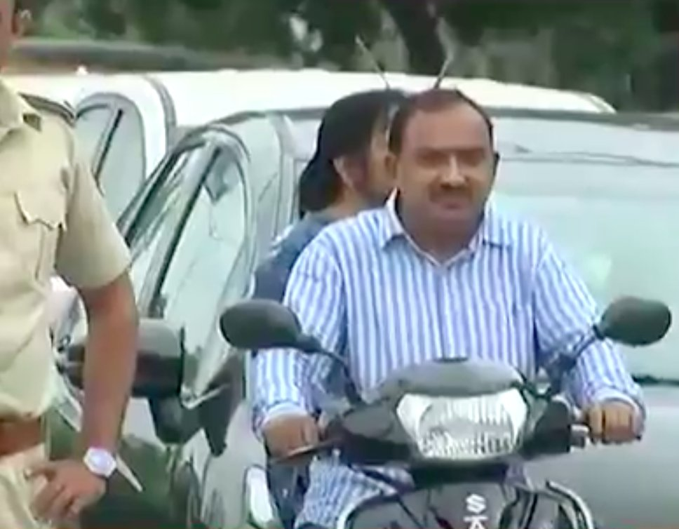 MLA Rakesh Shah pays fine for not wearing helmet