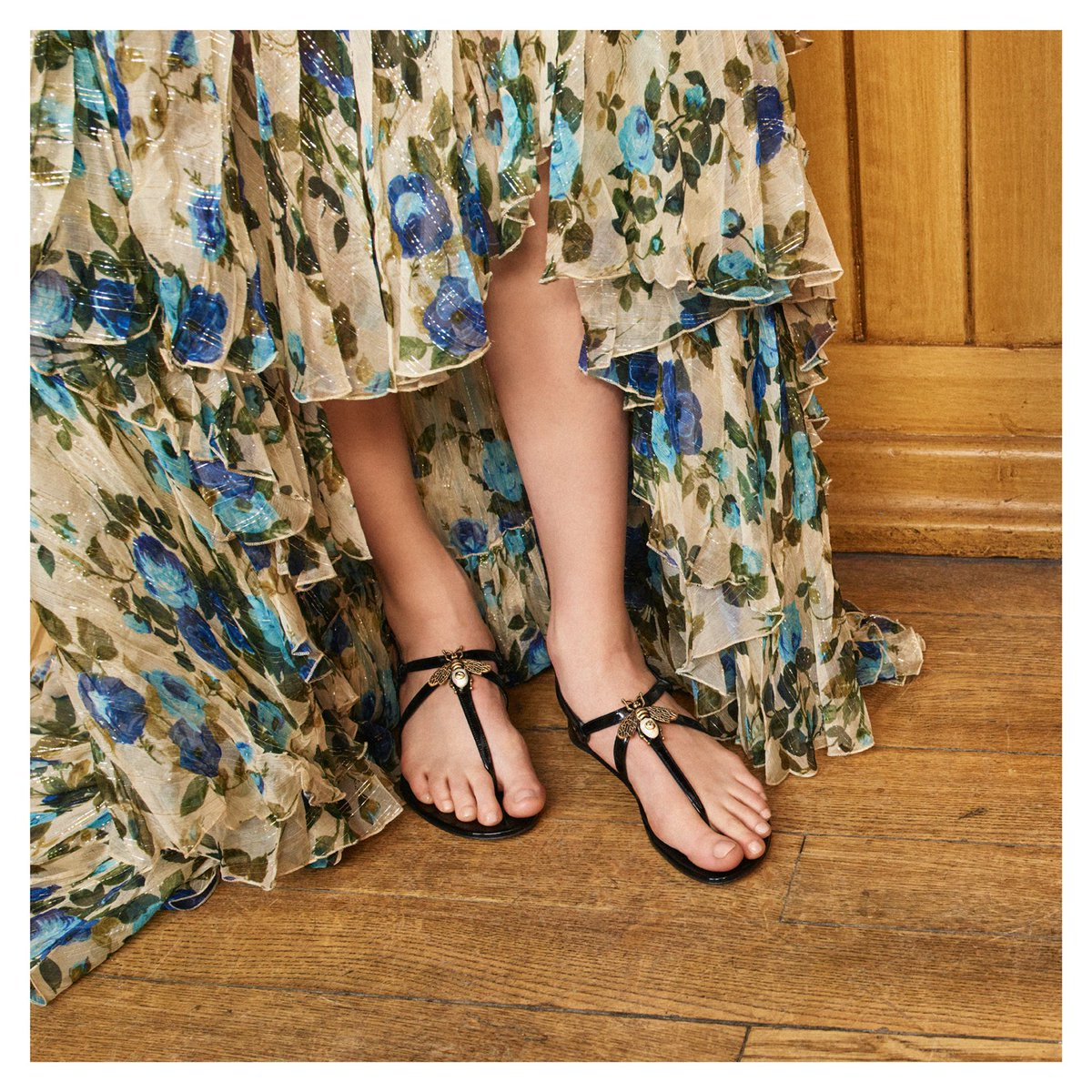 c05b87feaef ... symbol first seen in Gucci ready-to-wear in the 1970s—enhances the  front of patent leather flat sandals