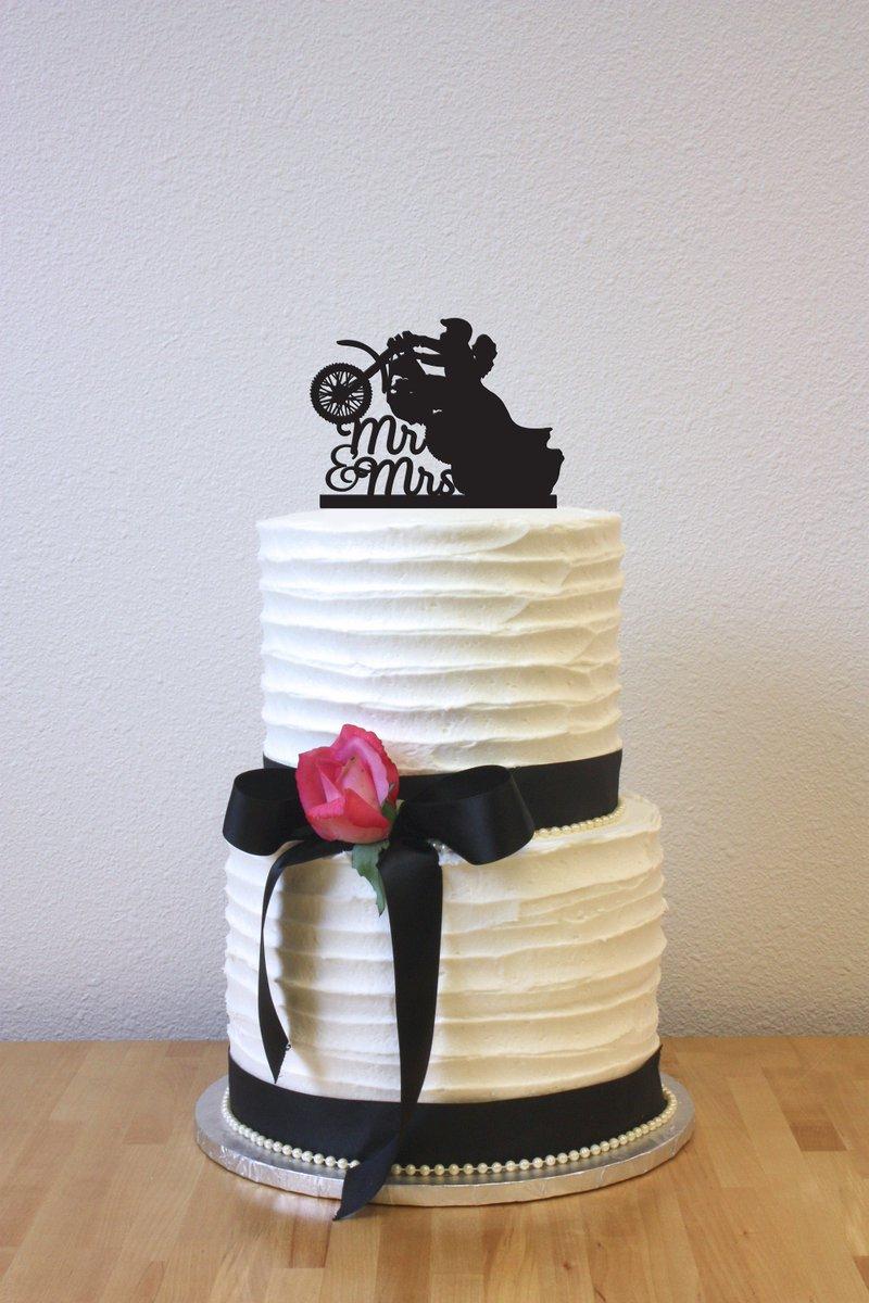 wedding cake topper bike hashtag on Twitter