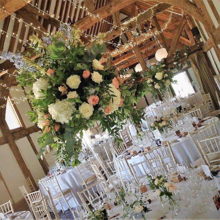 Stunning #Flowers from The Gorgeous Flower Company & twinkling #fairylights @PartyLightsUK - a winning combination! #weddings #barn #weddingideas #surreywedding