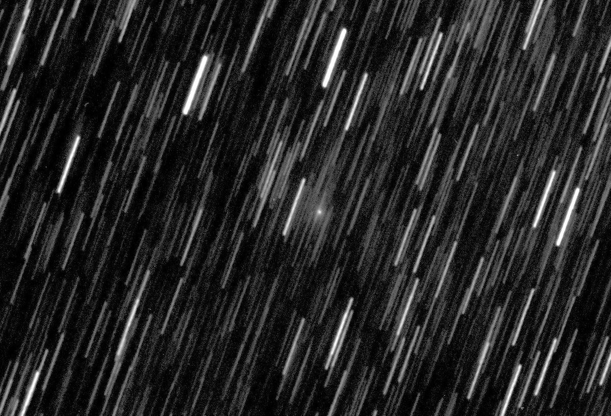 Lighthouse peering through a rain storm? Its actually star trails with a comet (NEOWISE C/2018 N1) in the centre, taken with @LCO_Global 0.4m at @SidingSpring using non-sidereal tracking.