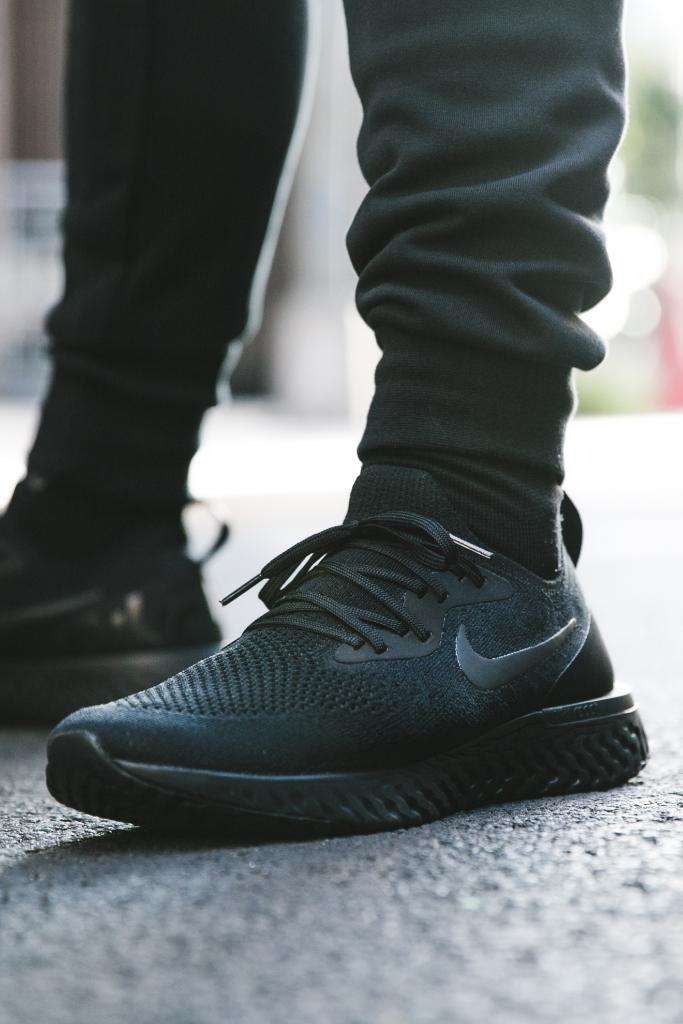 7689f8c800a8 blackout nike epic react flyknit triple black available now in store and  online