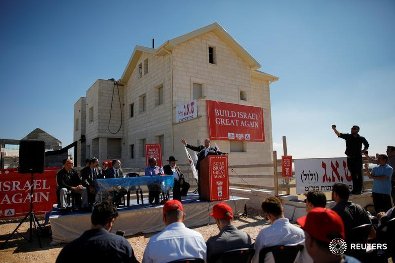 Former Arkansas Governor Mike Huckabee speaks during a ceremony marking the construction of a new housing complex in the Israeli settlement of Efrat in the occupied West Bank