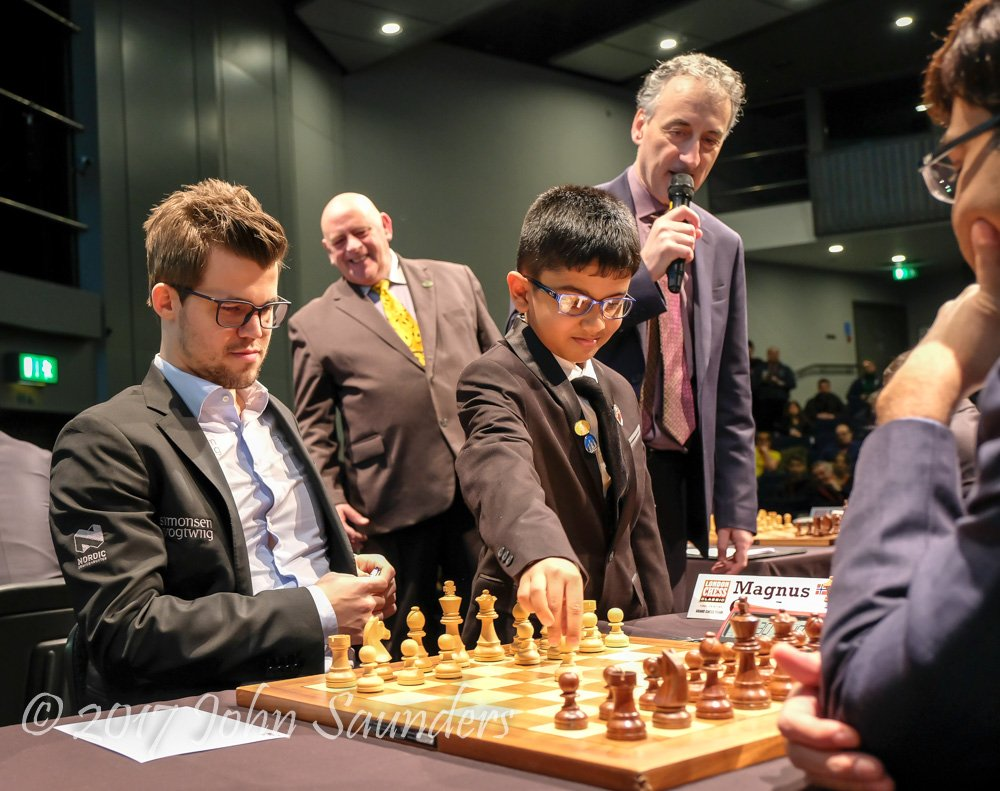 Shreyas Royal with Magnus Carlsen and Vishy Anand