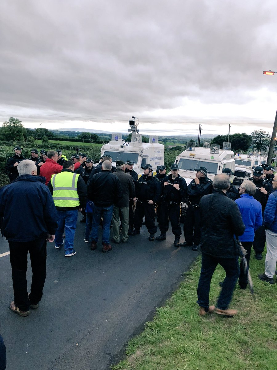 Mervyn Storey MLA &amp; @duponline reps forced to intervene after the Police block the Glebe Road, Rasharkin, to spectators contrary to the Parades Commission determination. Residents prevented from returning to their homes. Police have now allowed us through! <br>http://pic.twitter.com/IzshQEO5xr