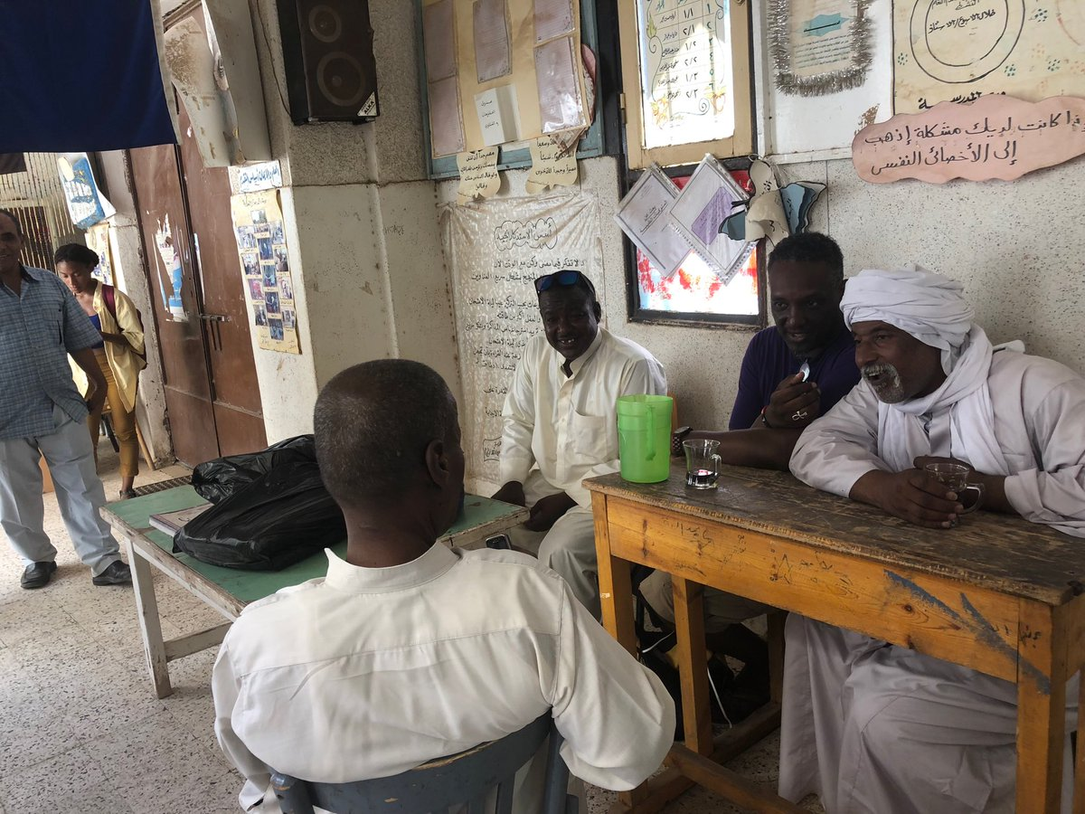 Already missing our Nubian family in Aswan. Good look on this photo! Farouk Karny, Kemet's legendary elder tour guide, shares a story with some village elders and me during our #HUStudyAbroadKemet2018 visit to a school on Elephantine Island last Monday. #IntergenerationalMbongi<br>http://pic.twitter.com/k3rSDYJfzP