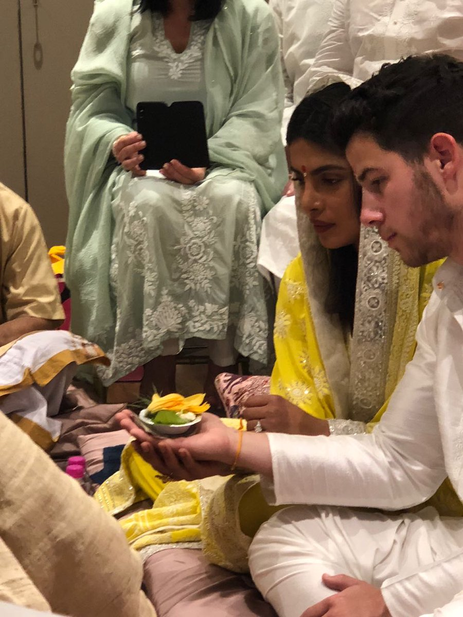 That aunty sneakily taking their photo is me #PriyankaNickEngagement