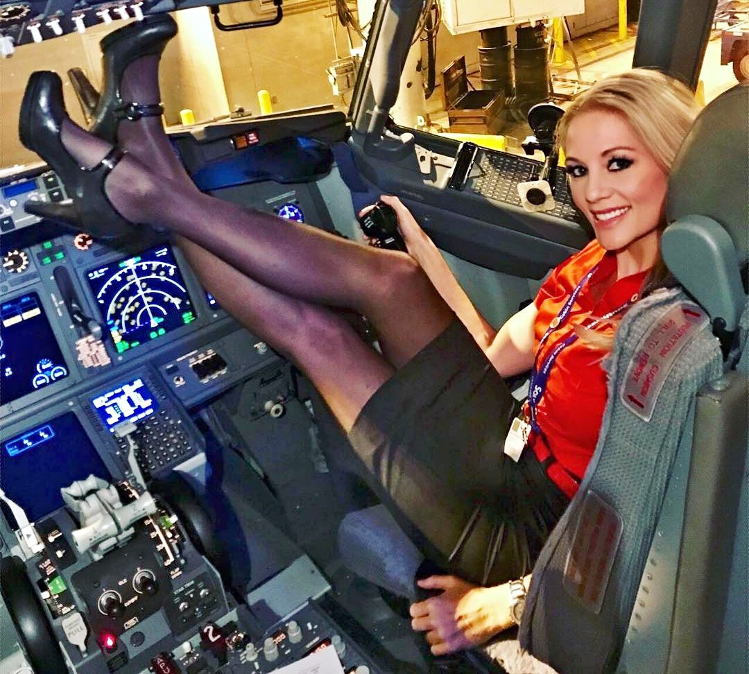 Pilot invites adult star into cockpit, lets her toy with controls