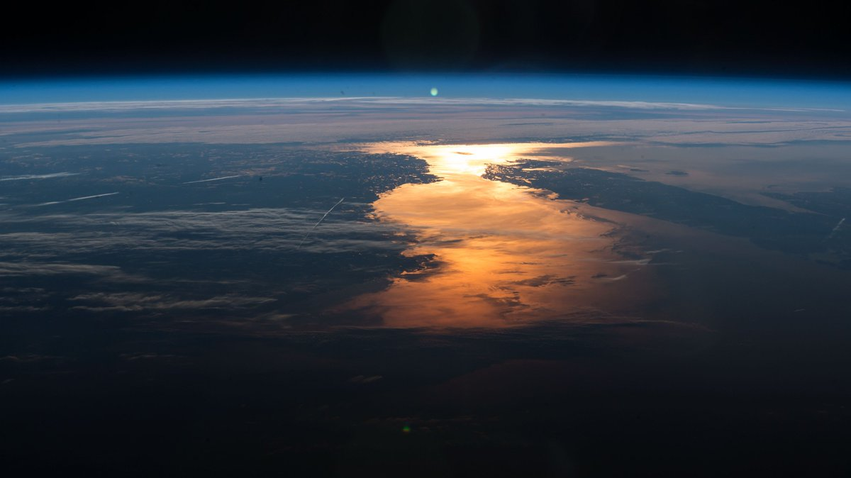 The Sun's glint lights up the waters from around the globe as the station orbited across North America, Hawaii, Africa and Europe.  1. The North Atlantic Ocean 2. The Hawaiian Ridge 3. Northern Botswana 4. The English Channel and North Sea