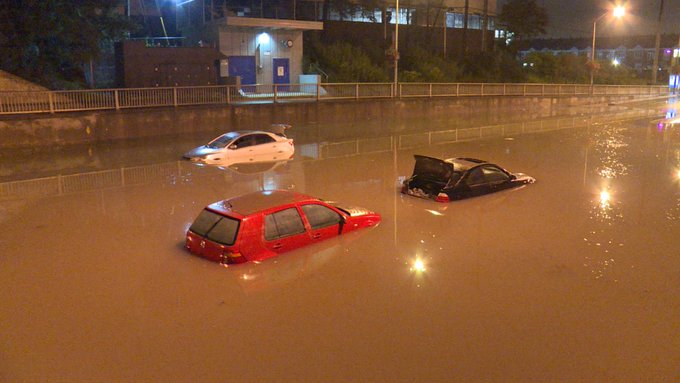 Toronto Flooding - As water starts to subside we can finally see the 3 vehicles in the underpass at Wilson Ave near Keele St. #onstorm Photo