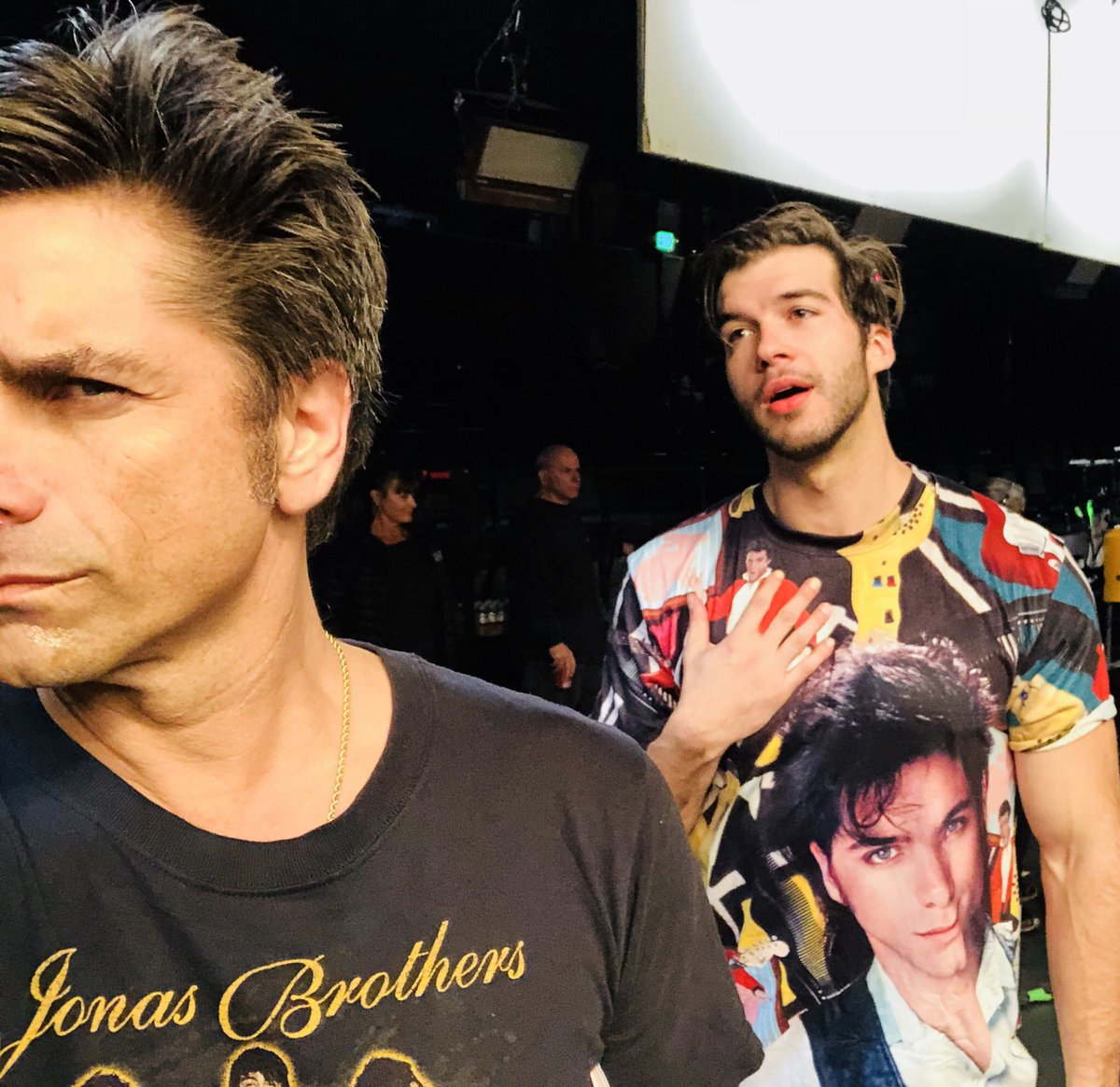 Sure @JohnStamos is a dream boat. But which one of us is wearing a cooler T-shirt? <br>http://pic.twitter.com/BqudebfYjJ