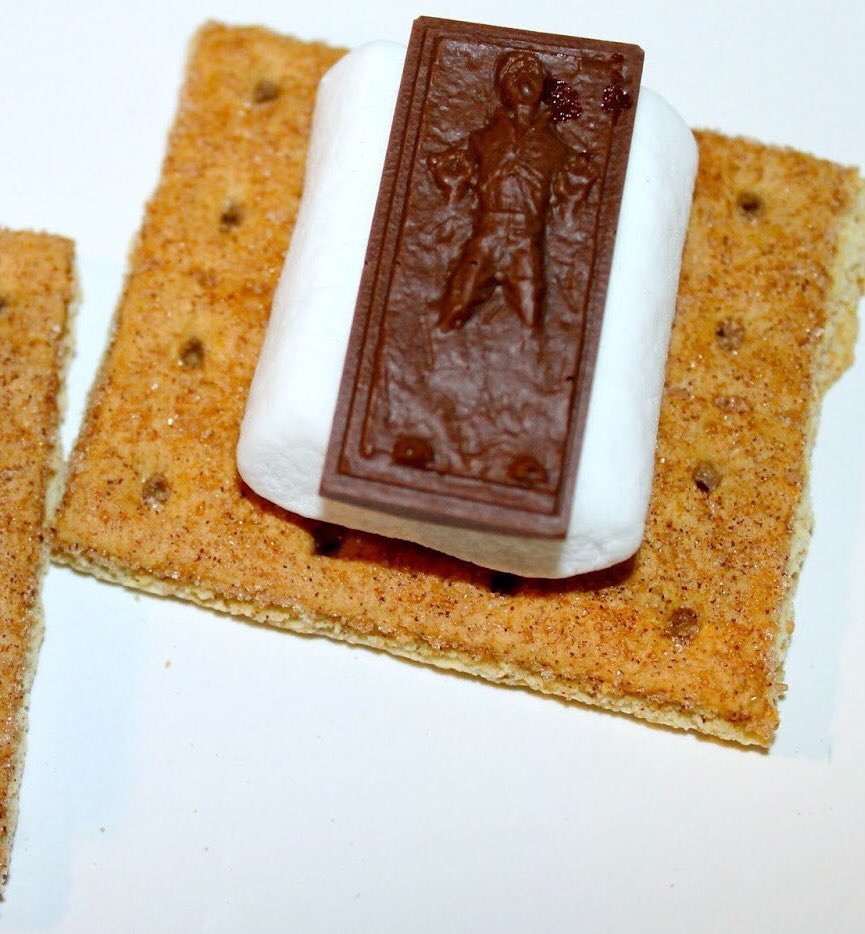 Happy #NationalSmoresDay everyone!  Not so fast, Han. <br>http://pic.twitter.com/bjo5GI6Ede
