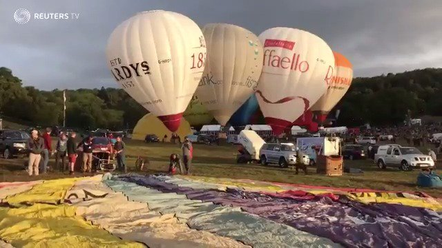 Weather can't deflate Britain's annual hot air balloon festival. See more from @ReutersTV: https://t.co/EvMbpo1x92 https://t.co/1wu4t2lfAi