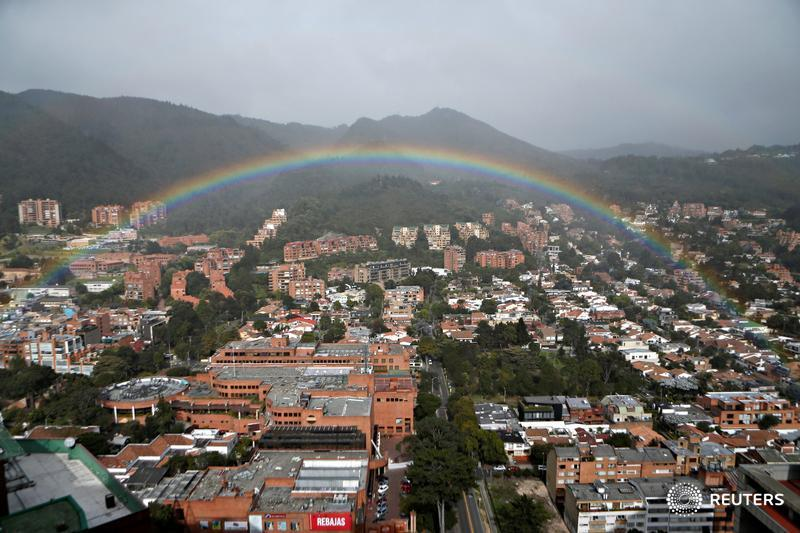 A rainbow appears over the eastern hills in Bogota, Colombia