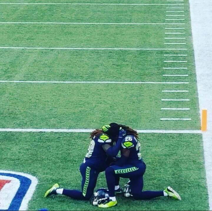 This picture is so moving. @Shaquemgriffin and @ShaquillG praying before their first NFL game together <br>http://pic.twitter.com/IKbI6si3g4