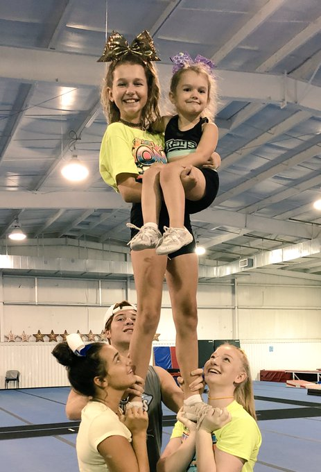 This @Grape_Rays got to cheer with her big sister today! 💙💚😎🍇 Photo