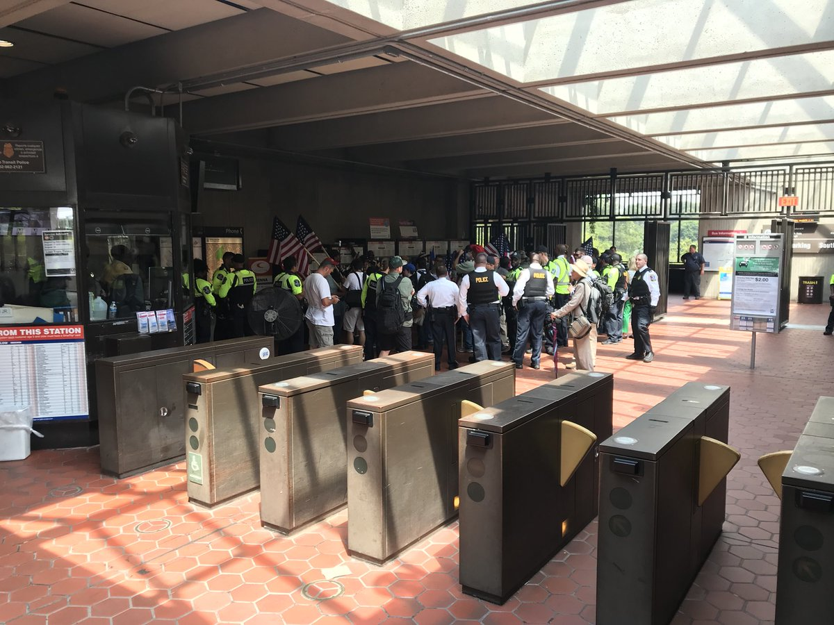 """Perhaps 25 """"Unite the Right"""" attendees, led by Jason Kessler, arrive at Vienna metro. A bunch of them don't have metro cards. <br>http://pic.twitter.com/FyuHvwFjJj"""